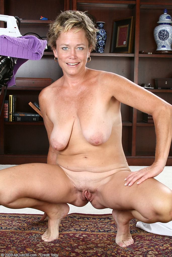 Over 50 mom probes herself with a big dildo Part 6