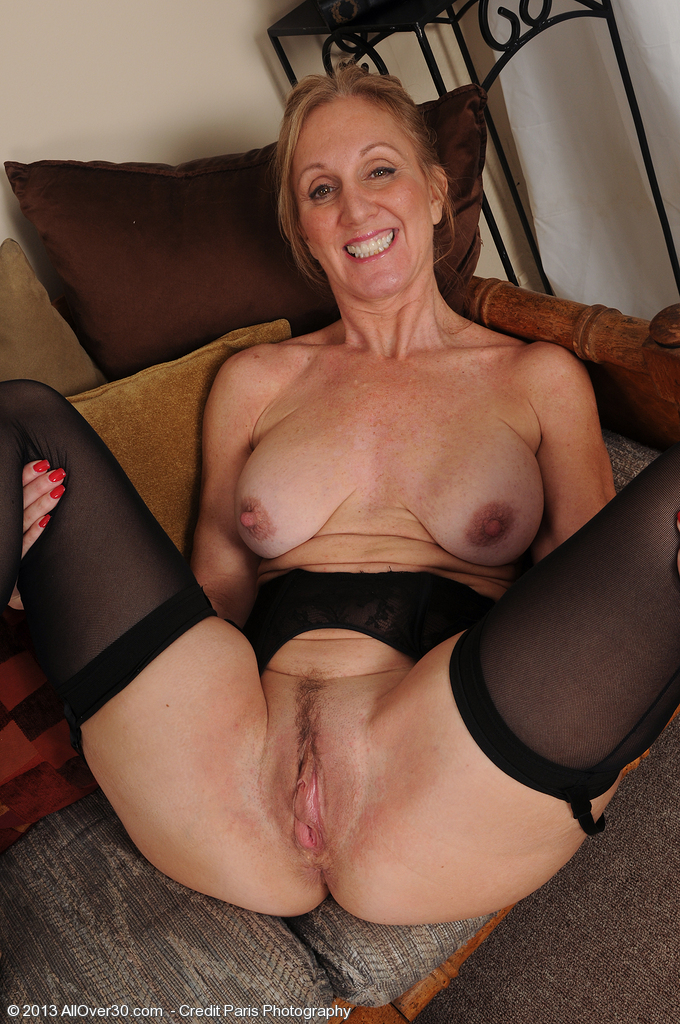 2 classy milfs have fun on the couch 2