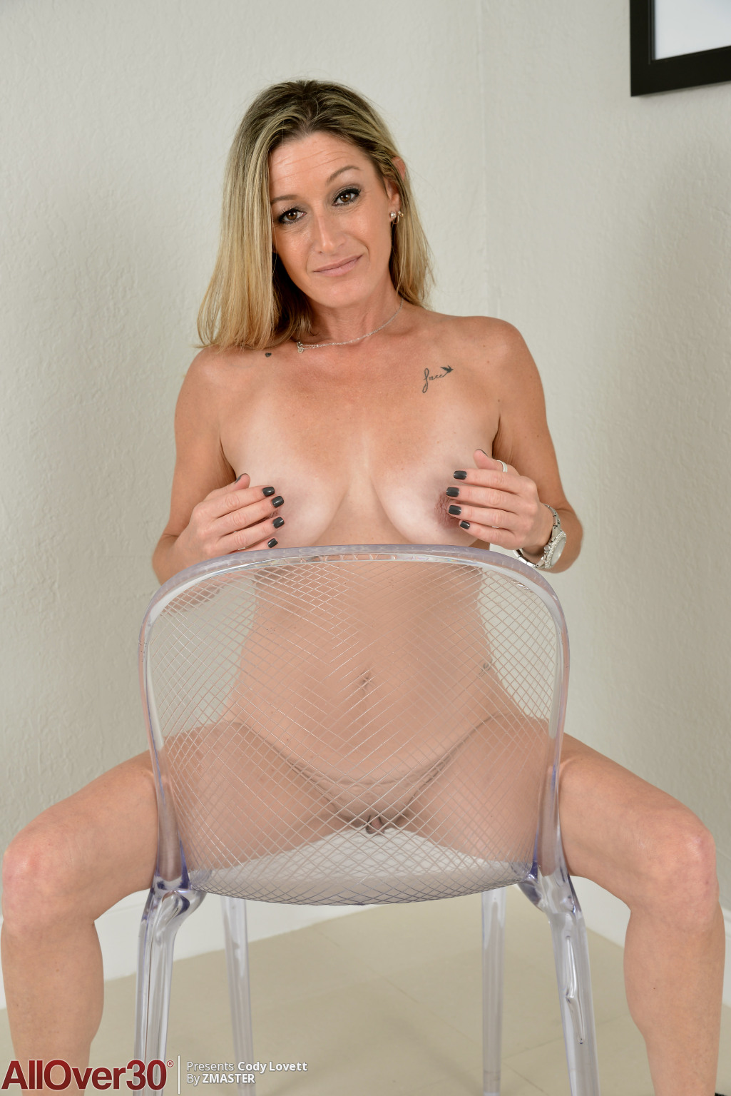 busty nude model sitting